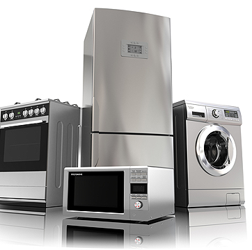 Photo of a refrigerator, washer, oven, and microwave.