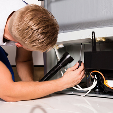 Photo of KitchenAid appliance repair service.