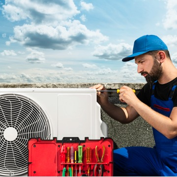 A man performing repair to a roof air unit, as part of HVAC Services in Bloomington IL