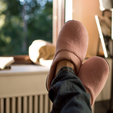 A woman relaxing in her slippers after Air Conditioning Installation in Bloomington IL
